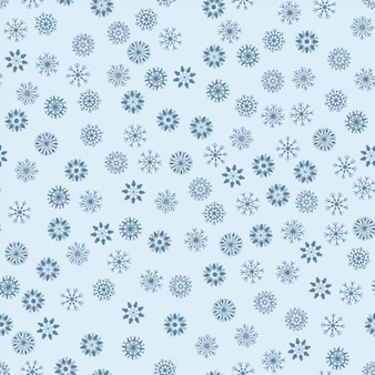 Seamless pattern which blue snowflakes in hand drawn style