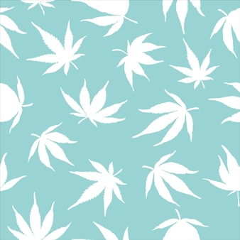 Seamless pattern of white cannabis leaves on a blue background
