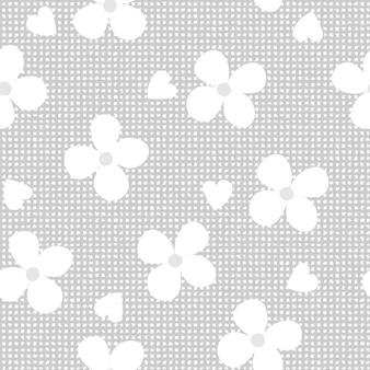 斑点のある灰色の背景にシームレスなパターンの白い花