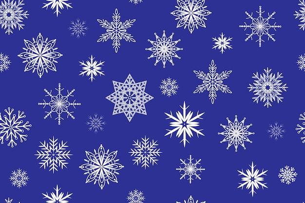 Seamless pattern white snowflakes on blue background