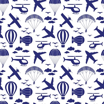 Seamless pattern with airplanes, helicopter, parachute, balloon, airship in the clouds