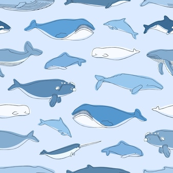 Seamless pattern with aquatic animals or marine mammals hand drawn on blue background - whales, narwhal, dolphins, cachalot, beluga. illustration for textile print, wrapping paper, wallpaper.