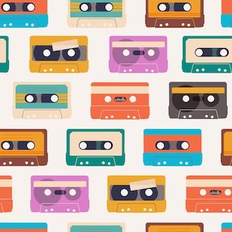オーディオカセットとのシームレスパターンレトロなデザインの繰り返しオーディオテープ