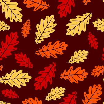 オレンジ、ベージュ、ブラウンの秋のオークの葉とのシームレスなパターン。壁紙、ギフト用紙、パターンの塗りつぶし、webページの背景、秋のグリーティングカードに最適です。