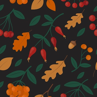 Seamless pattern with autumn red and orange rowan berries, oak leaves and rose hip on black.