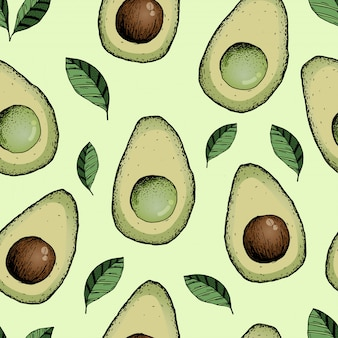 アボカドとのシームレスなパターン。手描きイラスト。緑のベクトル図の背景
