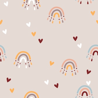 Seamless pattern with baby rainbows