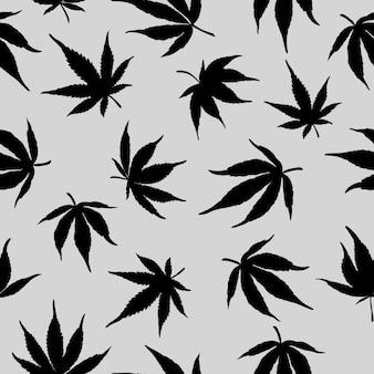 灰色の背景に黒い大麻の葉とのシームレスなパターン