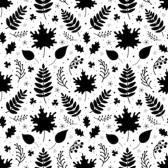 Seamless pattern with black fallen leaves twigs and botanical elements