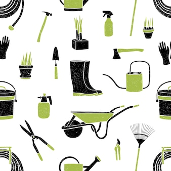 Seamless pattern with black and green gardening tools on white