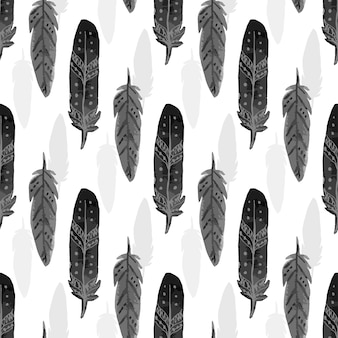 Seamless pattern with black watercolor feathers. ethnic feather texture