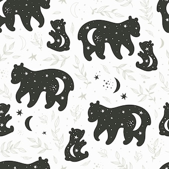 Seamless pattern with black and white silhouettes of a bear and teddy bear