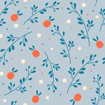 나뭇가지와 열매와 원활한 패턴 파란색 배경 패턴에 빨간 열매