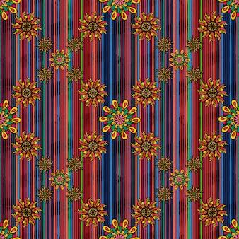 明るくカラフルな描かれた曼荼羅の花とのシームレスなパターン