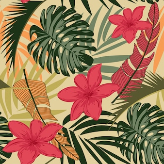 Seamless pattern with bright tropical leaves and flowers