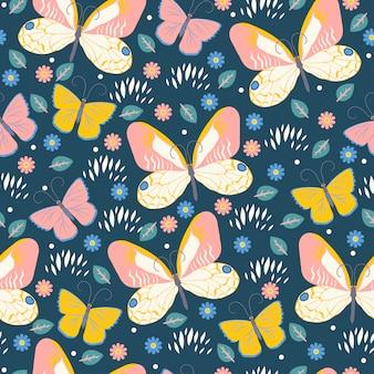 蝶と花とのシームレスなパターン。グラフィック。