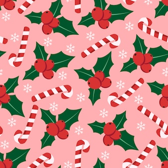 Seamless pattern with candy cane, holly berry and snowflakes.