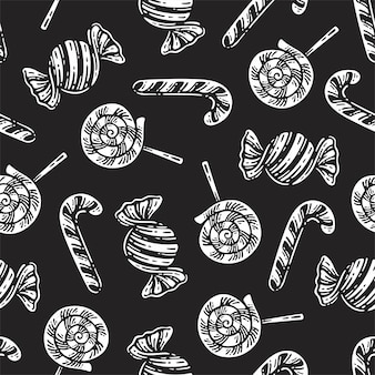 Seamless pattern with candy wrapper, lollipop, and candy cane on dark background.