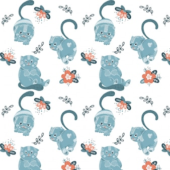 Seamless pattern with cartoon blue cats and flowers