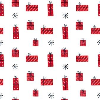 Бесшовный фон с рождественскими подарками на белом фоне.