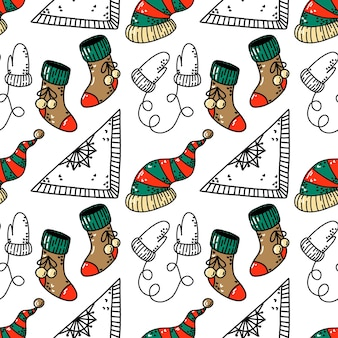 Seamless pattern with christmas socks hat and mittens