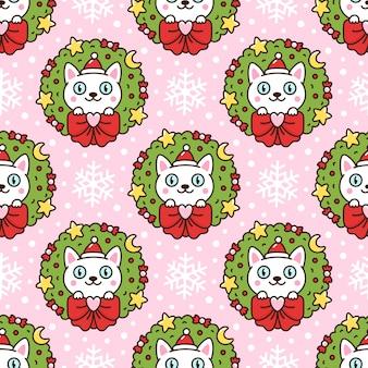 クリスマスリースとサンタの帽子のかわいい漫画の猫とのシームレスなパターン
