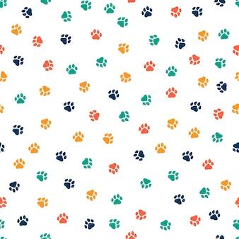 カラフルな犬の足とのシームレスなパターン