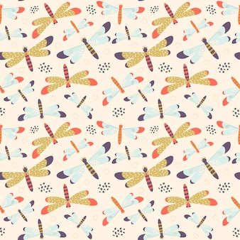 Seamless pattern with colorful dragonflies