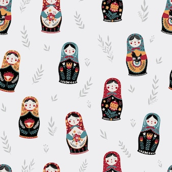 Seamless pattern with colorful russian dolls and leaves matryoshka background