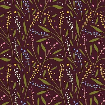 暗い背景にカラフルな小さな花とのシームレスなパターン