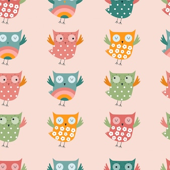 Seamless pattern with colourful owls.
