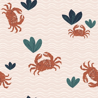 Seamless pattern with crabs and plants on the sand