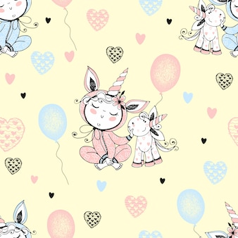 Seamless pattern with a cute baby in pajamas with his toy unicorn and balloons.