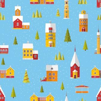降雪のクリスマスや新年のお祝いのために飾られたかわいい建物や木々とのシームレスなパターン