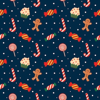 Seamless pattern with cute cartoon christmas candy isolated on blue background