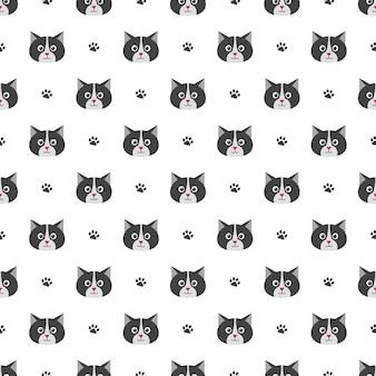 かわいい猫と足跡とのシームレスなパターン