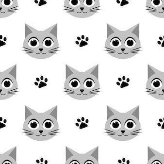 かわいい猫と足跡のシームレスなパターン Premiumベクター