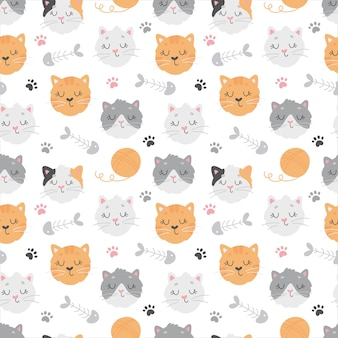 Seamless pattern with cute cats, clew, footprints and fish bones Premium Vector