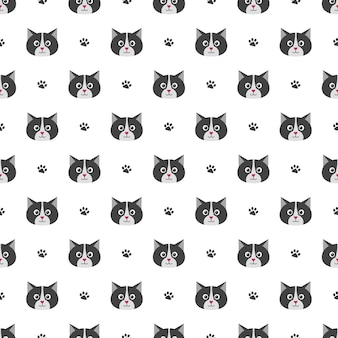 Seamless pattern with cute cats and footprints