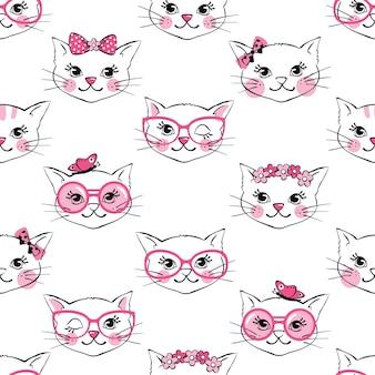 白い背景で隔離のかわいいファッション猫とのシームレスなパターン。