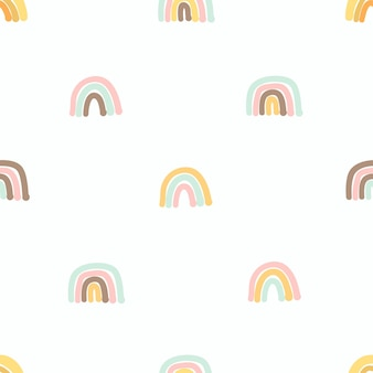 Seamless pattern with cute hand drawn rainbows. cozy hygge scandinavian style template for fabric, packaging, kids t shirt design. vector illustration in flat cartoon style