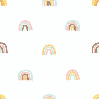 Бесшовный фон с милой рисованной радуги. уютный шаблон hygge в скандинавском стиле для ткани, упаковки, дизайна детской футболки. векторные иллюстрации в плоском мультяшном стиле