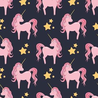 Бесшовный фон с милыми розовыми единорогами и звездами на темном фоне для детского текстиля
