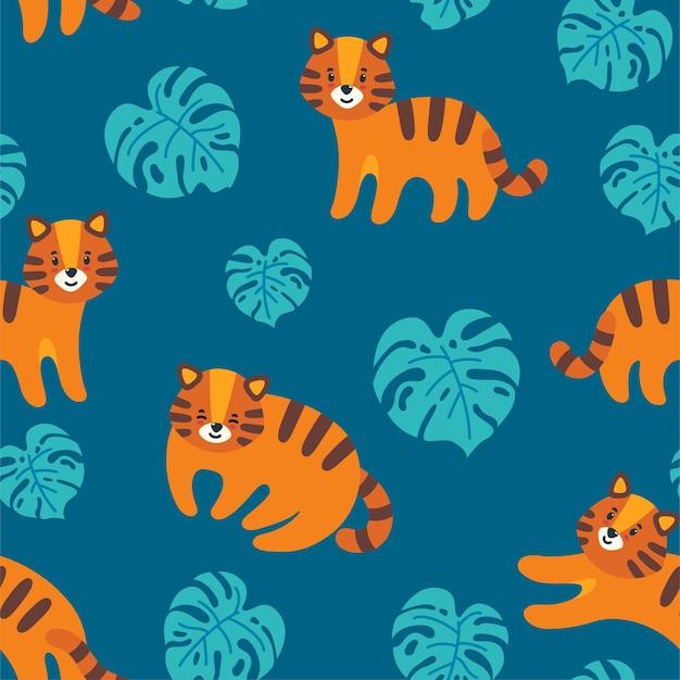 Бесшовный фон с милыми тиграми и листьями монстеры на синем фоне экзотические растения и кошки