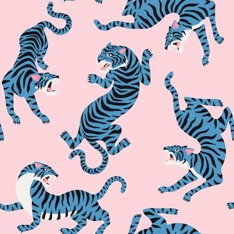 Бесшовный узор с милыми тиграми на фоне.