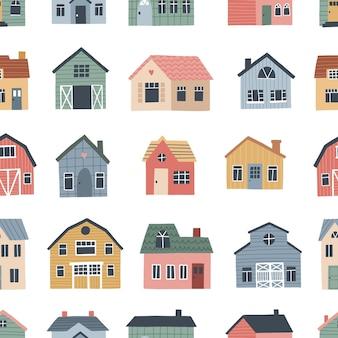 かわいい村の家とのシームレスなパターン。保育園のテキスタイルや壁紙のデザインのための手描きのベクトルイラスト。