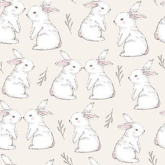 かわいい白いウサギとのシームレスなパターン。