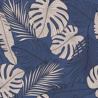Seamless pattern with dark monstera leaves on blue background