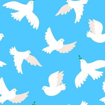 Бесшовный фон с голубями на синем фоне