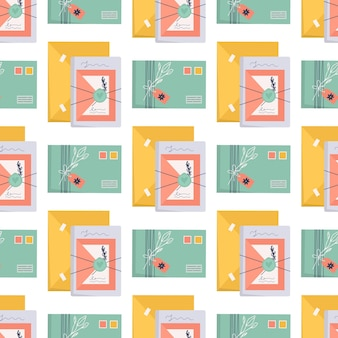 Seamless pattern with envelopes and stamps. craft paper letter, ribbon, branch and decor elements.